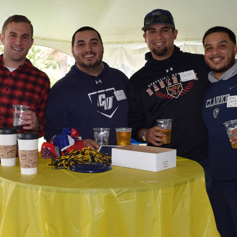 Group of alumni at the homecoming tent party