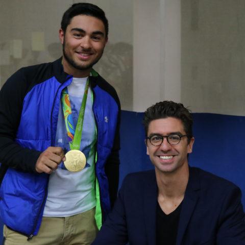Clarke student wearing Anthony Ervin's medal