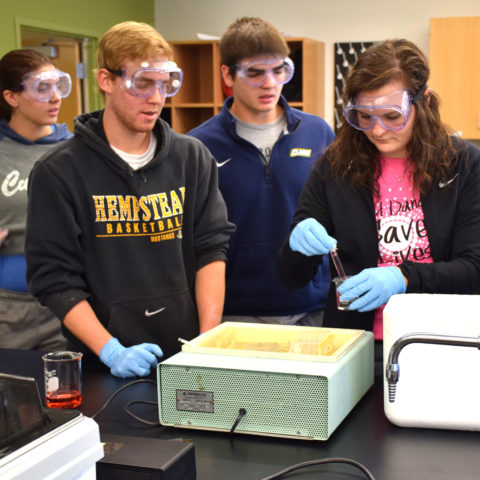 Students completing lab work as part of Clarke University Chemistry Degree Program