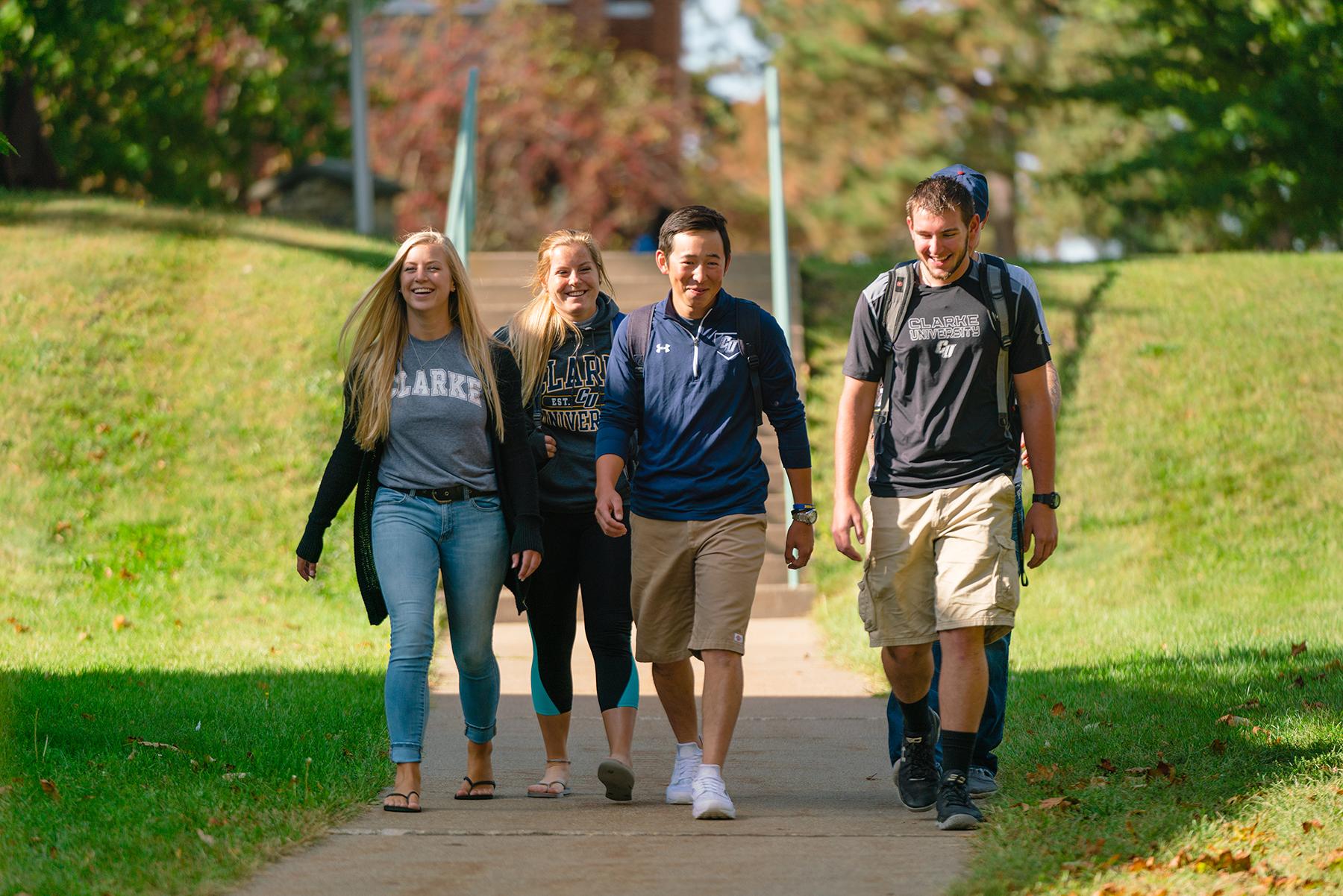 Clarke University transfer students walking between class.
