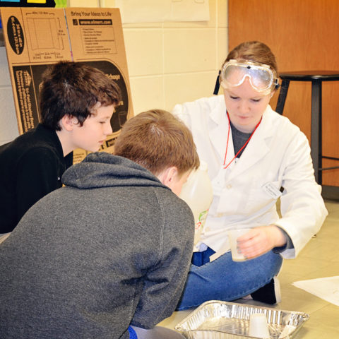 Clarke Education Major working with elementary students in lab