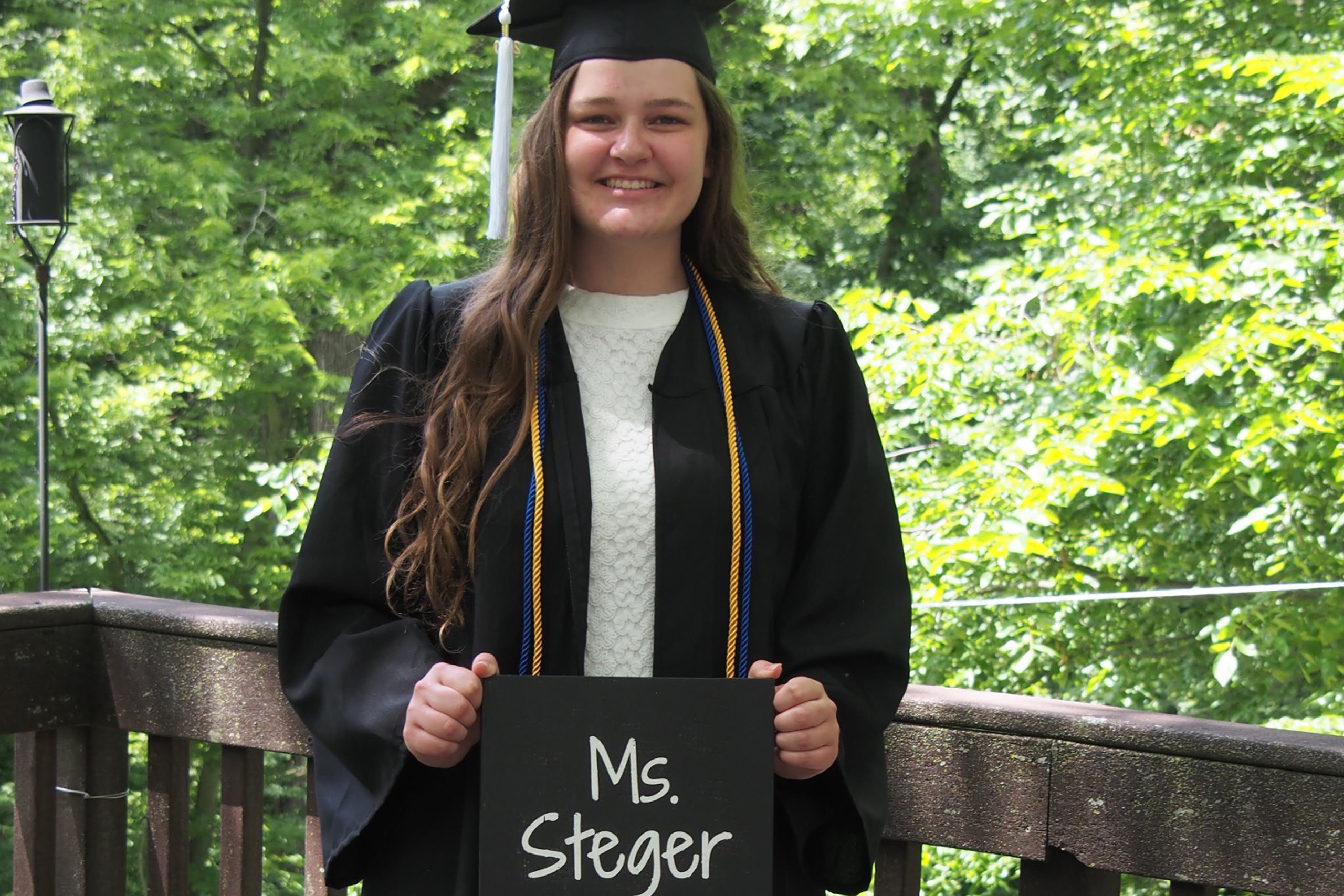 Clarke University education graduate, Lindsey Steger, posing with teaching