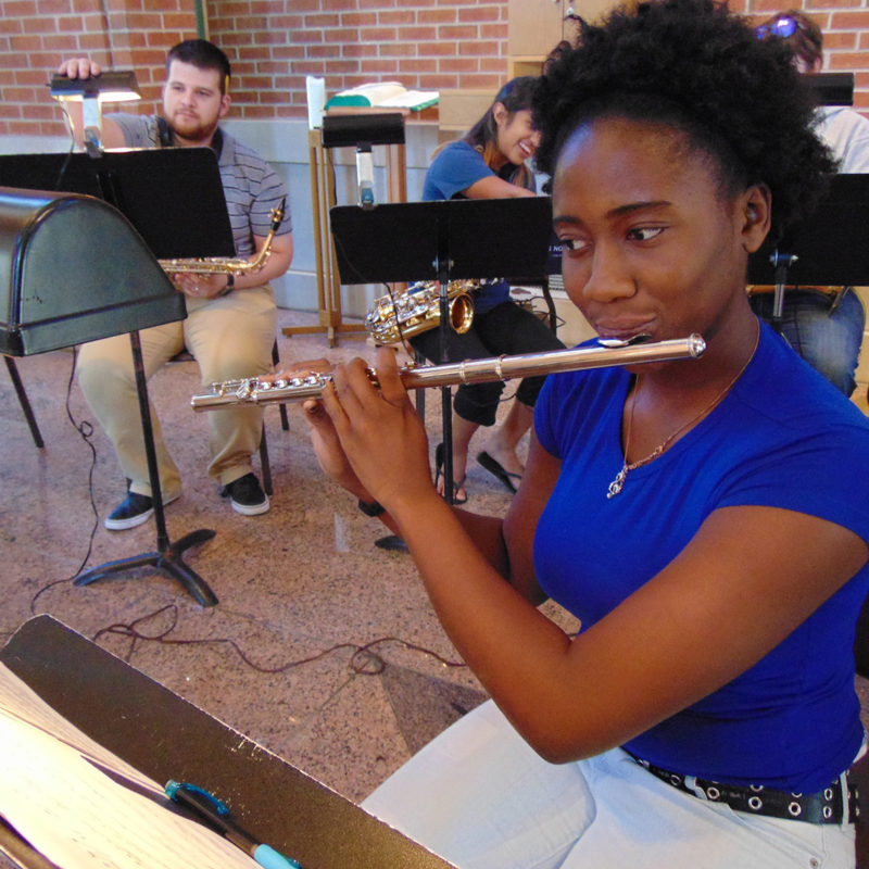 Clarke University Music Major Students Performing in a Band