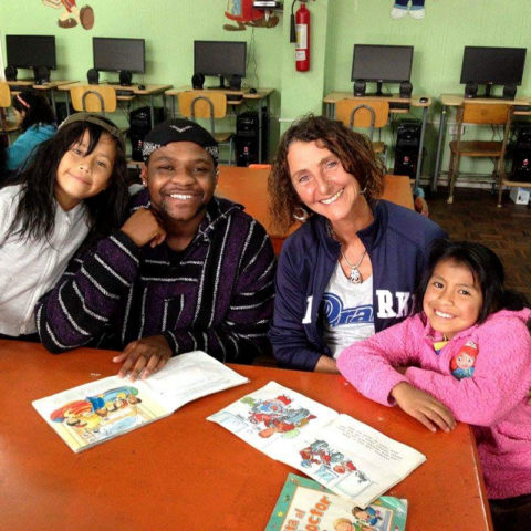 Reading to children while studying participating in the Ecuador study abroad trip.