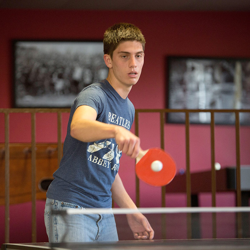 Clarke student playing ping-pong