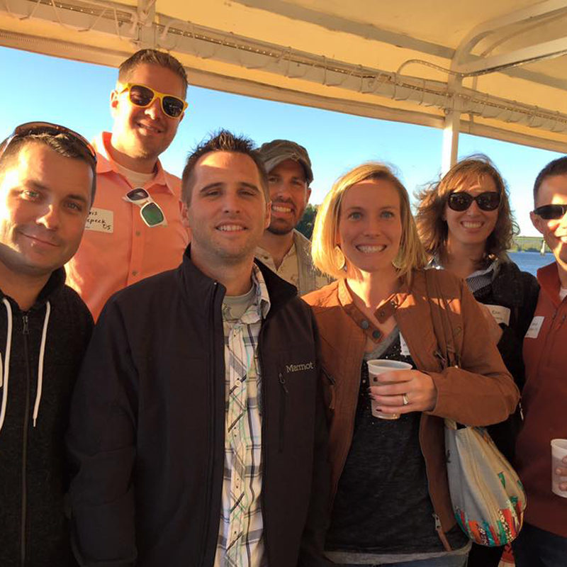Alumni smiling while being on the river cruise